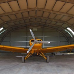 A frontal view of the agricultural plane inside its new home.