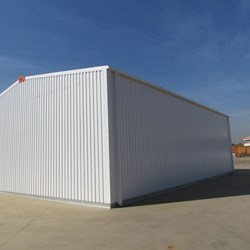 rear view of a hangar Delta, structure is made from galvanized steel, cladding is galvanized and pre painted in white to reflect heat