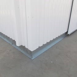 The building is sealed to the floor with a galvanized profile sheet