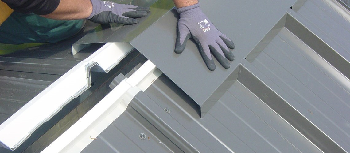 the installation of a roof ridge on a Frisomat steel building
